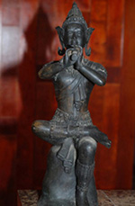 image of Thai statue of flute player
